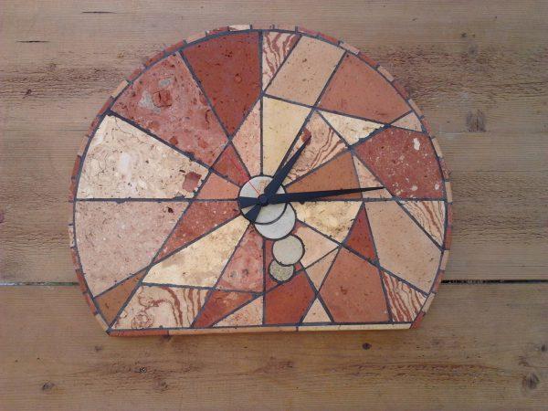 <span>Orologio Geometrico</span><i>→</i>